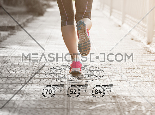 Fitness woman training and jogging in summer park, close up on running legs