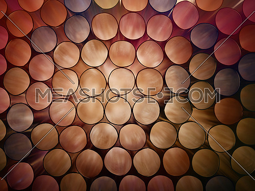 Abstract warm brown and beige toned vivid colorful background texture of backlit stack drinking straw circles