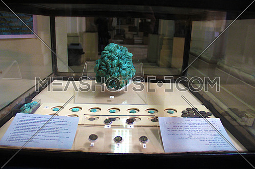 a photo from inside the Egyptian museum showing display of ancient coins used during the pharaohs civilization