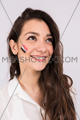 close up for young lady has a a small paint of egyptian flag on her cheek
