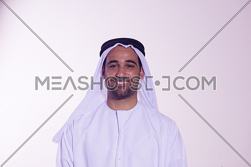 Portrait of happy  young arab business man isolated on white background