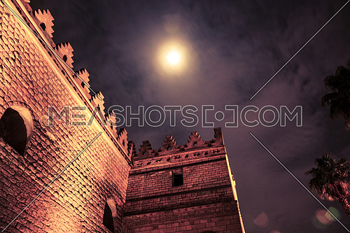 Wall of El Hakim Mosque showing the full moon at night