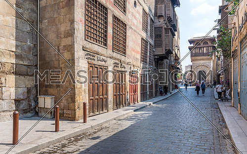 Cairo, Egypt- June 26 2020: Moez Street with few local visitors and Sabil-Kuttab of Katkhuda Mamluk era historic building at the far end during Covid-19 lockdown period, Gamalia district, Old Cairo
