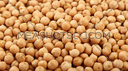 Dried chickpea beans close up pattern background, high angle view