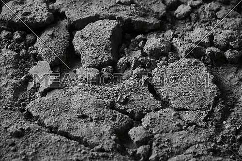 Top shot for floor with cement dirt and small  cracked blocks monochrome.