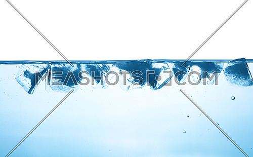 Close up water surface with ice cubes isolated on white background, low angle underwater view