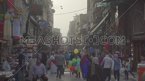 Fixed shot for people walking in El Moez Street in Cairo at day