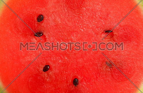 Close up full frame background texture of fresh red ripe juicy watermelon cut slice