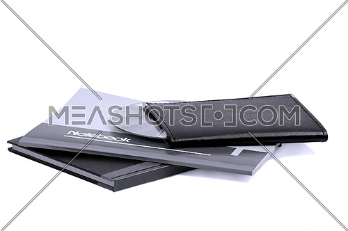 assorted notebooks with a cd flat piled on white background,blue filter