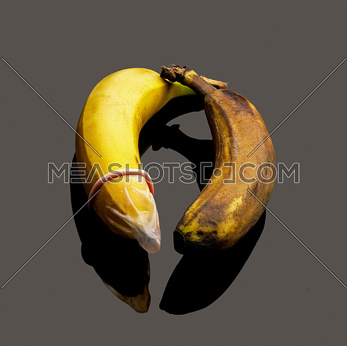 condom on banana representing safe sex concept
