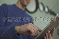 a man using electronic touch devices in a home