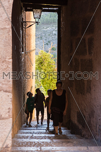 Tourists walk along the alleys close to the cathedral of Cuenca to the evening, Cuenca, Spain