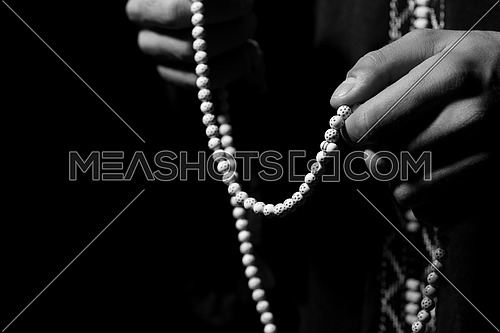 Close-Up Of Young Muslim Man With Rosary Praying In Mosque