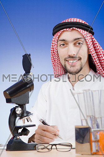 Arab chemist working in lab