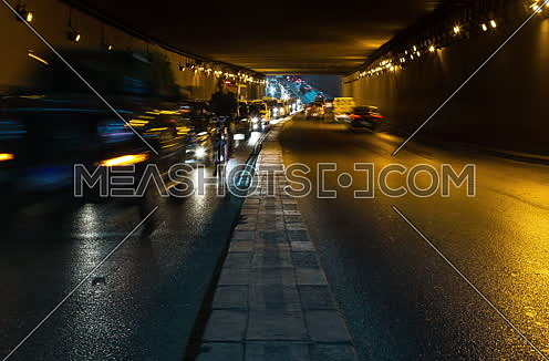 Track Right Shot for traffic from inside  Al Thawra Tunnel at Night