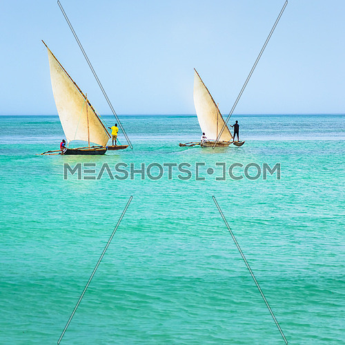 In the picture two traditional catamarans(Ngalawa) on amazing turquoise water in the Indian ocean.