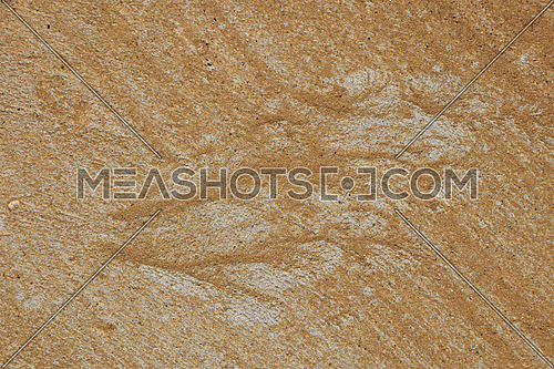 Silhouette of butterfly or bird wing made of sand and gravel by water flow at concrete surface