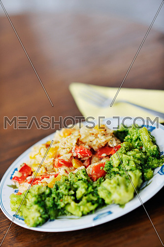 healthy vegetarian vegetables and rice food in dish at kitchen