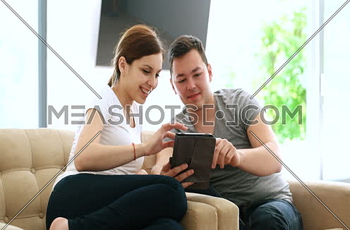 Young Couple using interent on digital tablet
