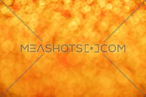 Golden red glitter bright magic light circles christmas abstract blur effect background