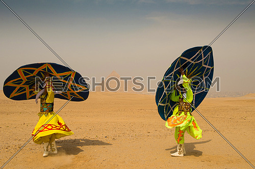 traditional Egyptian sufi dancer performing at Giza pyramids with