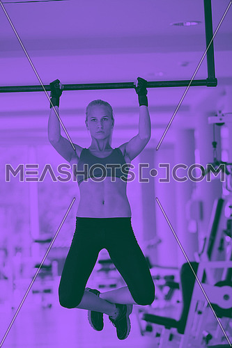 healthy lifestile, young woman in fitness gym lifting on bar and working on her back and hands muscles duo tone