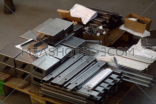 Final stage CNC material. Metal products after processing on CNC machines stand on pallets ready for transport. High quality photo