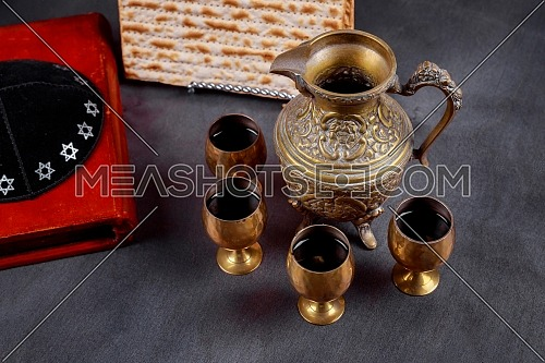 Pesach Passover symbols of great Jewish holiday. Traditional matzoh and wine in glass. Retro style