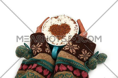 Close up two woman hands hold and hug big full cup of latte cappuccino coffee with heart shaped chocolate on milk froth isolated on white background, high angle view
