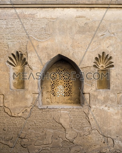 Perforated arched stucco window decorated with floral patterns, one of the traditions of the Mamluk era, Outer wall of Mosque of Ibn Tulun, Sayyida Zaynab district, Medieval Cairo, Egypt