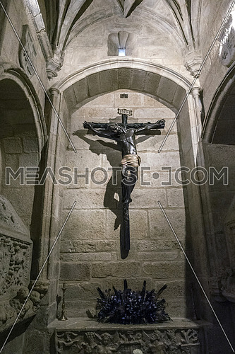 Caceres, Spain - july 13, 2018: Holy Crucifix of Santa Maria de Jesus (Black Christ) in your chapel, is an anonymous carving and is in the cathedral of Santa Maria, Caceres, Spain