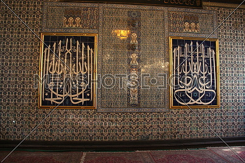 a photo for a old mosque in Cairo, Egypt showing the fine art architecture on one of the walls