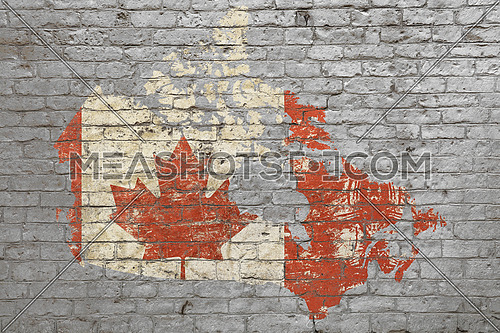 Grunge distressed map shaped flag of Canada painted on old weathered grey brick wall