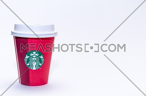 Starbucks takeaway paper cup, in special design for Christmas on a white background; December 2018 - Cairo, Egypt.