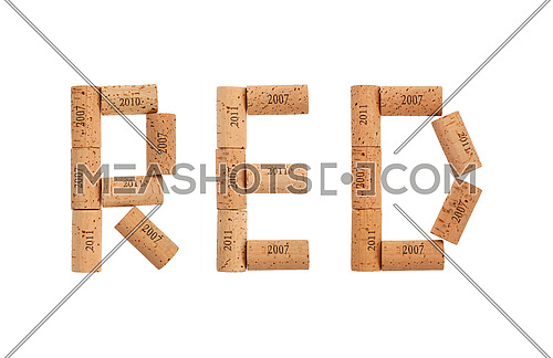 Word RED shaped by natural wooden wine bottle corks of different vintage years isolated on white background