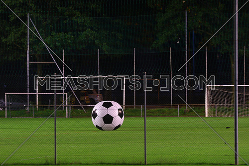 Giant soccer ball on a playing field at night