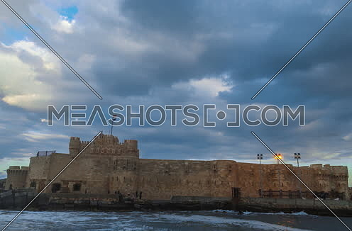 Track Left Long Shot outside Citadel of Qaitbay shows sea waves at Cloudy day