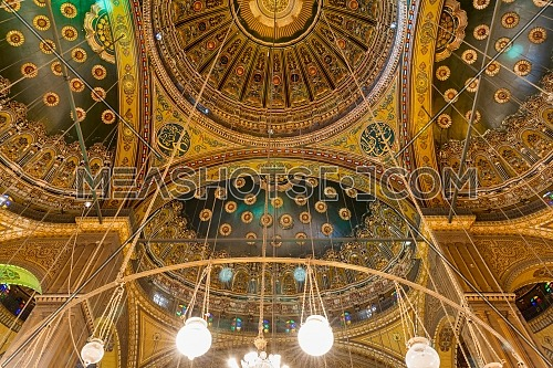 Ceiling of the great Mosque of Muhammad Ali Pasha - Alabaster Mosque - suited in the Citadel of Cairo, Egypt, with intersection of four domes decorated with green and golden floral patterns
