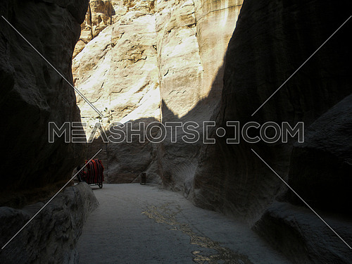 A Canyon between two big mountains in a passage way that leads to Petra historical location, Jordan