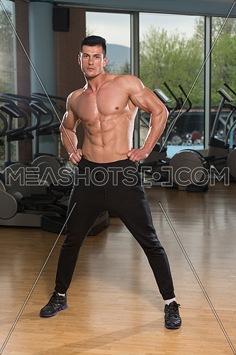 Young Man Stretching Before Exercising In Fitness Center Healthy Lifestyle Concept