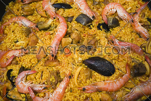 Paella with prawns and mussels, typical Spanish dish, ingredients of the Mediterranean, Spain