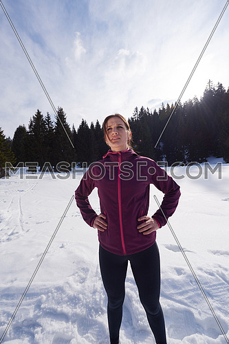 yougn woman jogging outdoor on snow in forest, healthy winter lifestyle and recreation