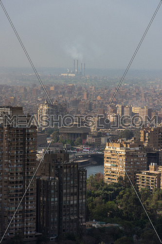 cairo city egypt capital  with power factory and air pollution in horizon