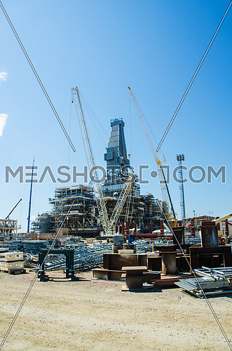 Offshore drilling during construction onshore
