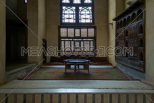 Room at ottoman era old historic El Sehemy house at Gamalia district, Cairo, Egypt, with Interleaved wooden window - Mashrabiya - and wooden ornate embedded cabinet