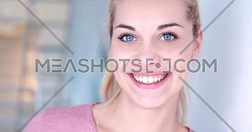 close-up portrait of a beautiful young blond woman