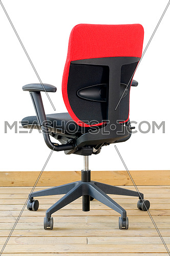modern red office chair on wood floor over white background