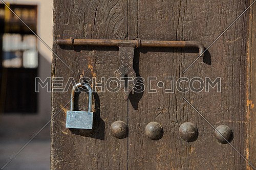 a vitage old wooden door with lock