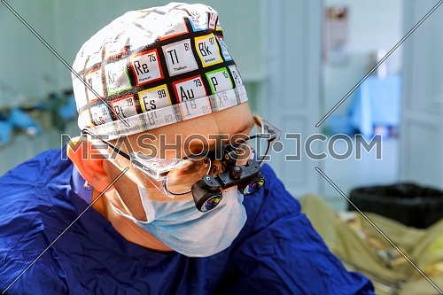 Cardiovascular surgery doctor in surgery center for interventions with in surgery operation