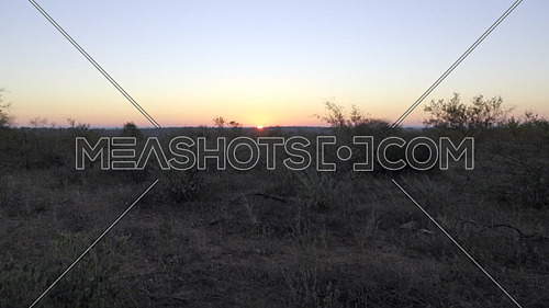 Sun peeks over horizon in an early morning sunrise in South Africa